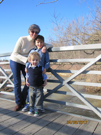 Connie Bonello standing on a bridge with two children