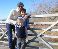 Connie Bonello standing on a bridge with two children
