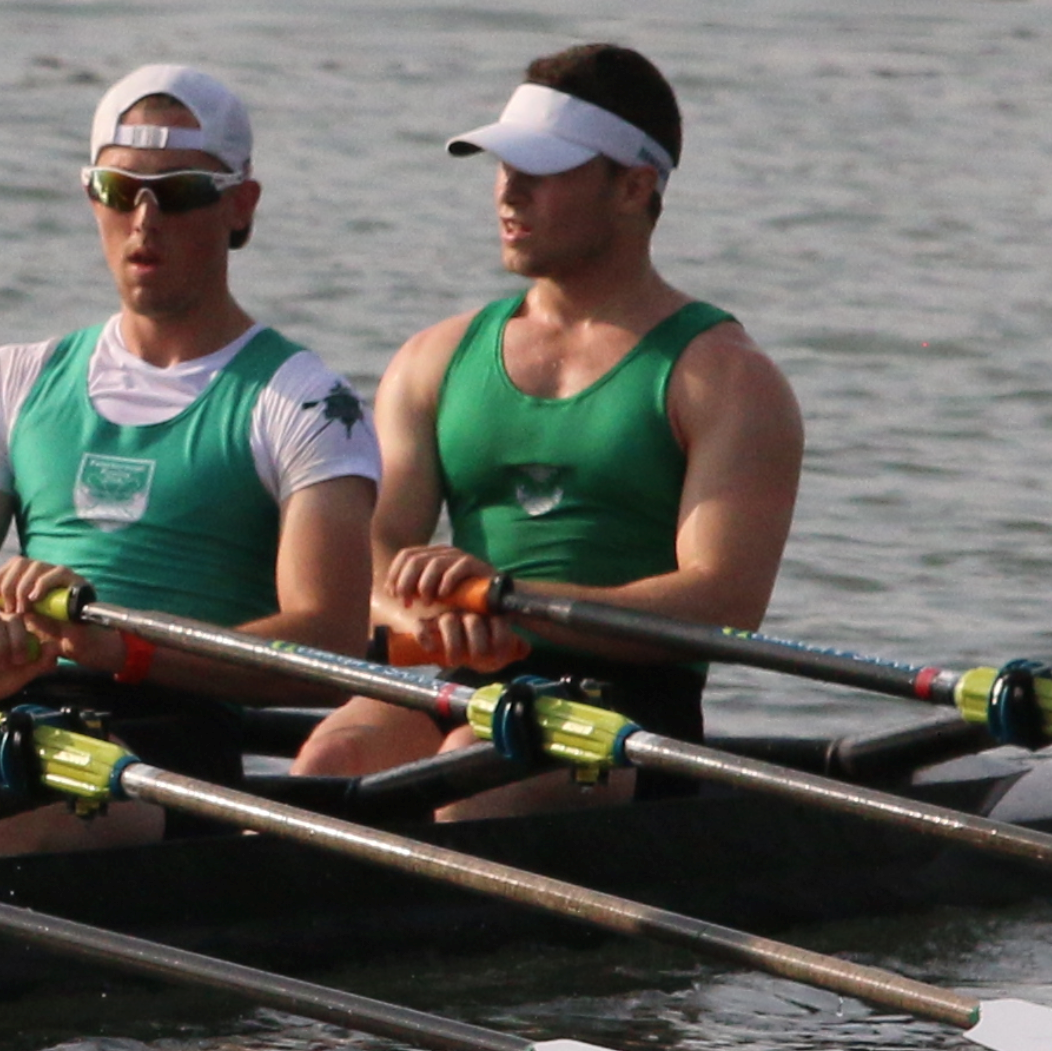Dayton rowing, wearing a green uniform