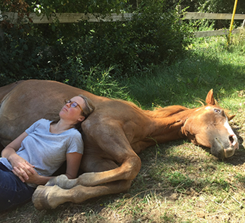 Karen Wickerson sleeping on her horse Tizzy