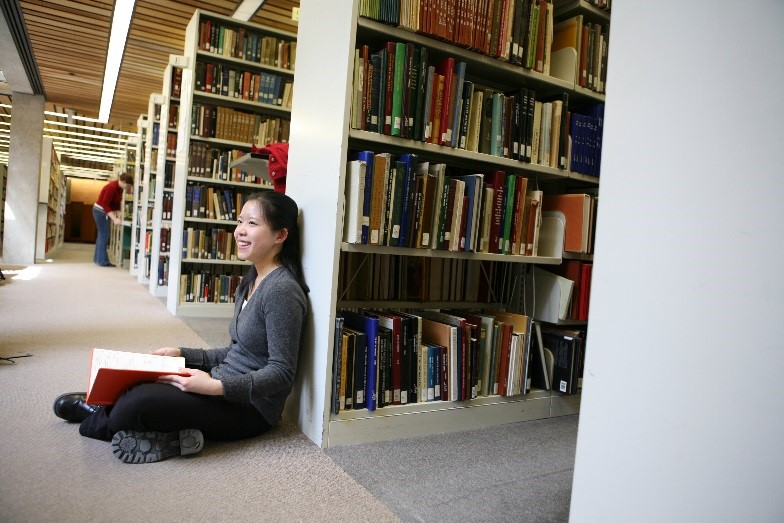 Kitty Cheung reads in the Bata Library stacks