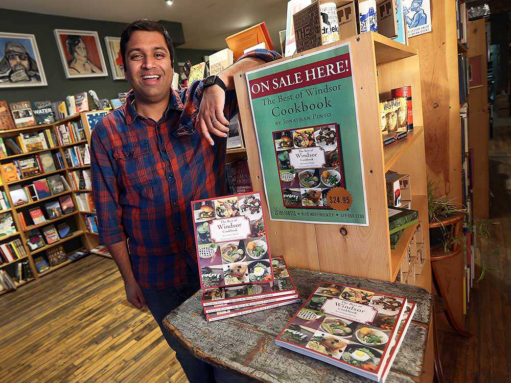Jonathan Pinto poses with books