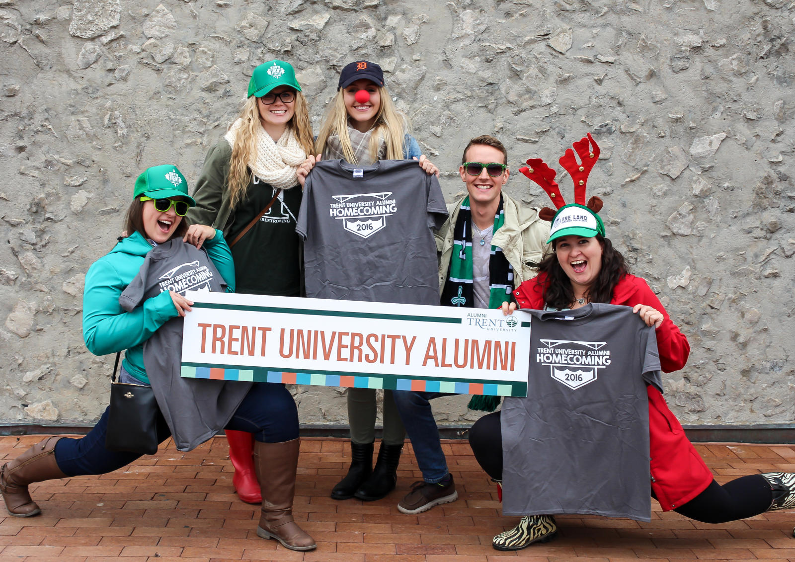 5 young trent alumni at welcome tent