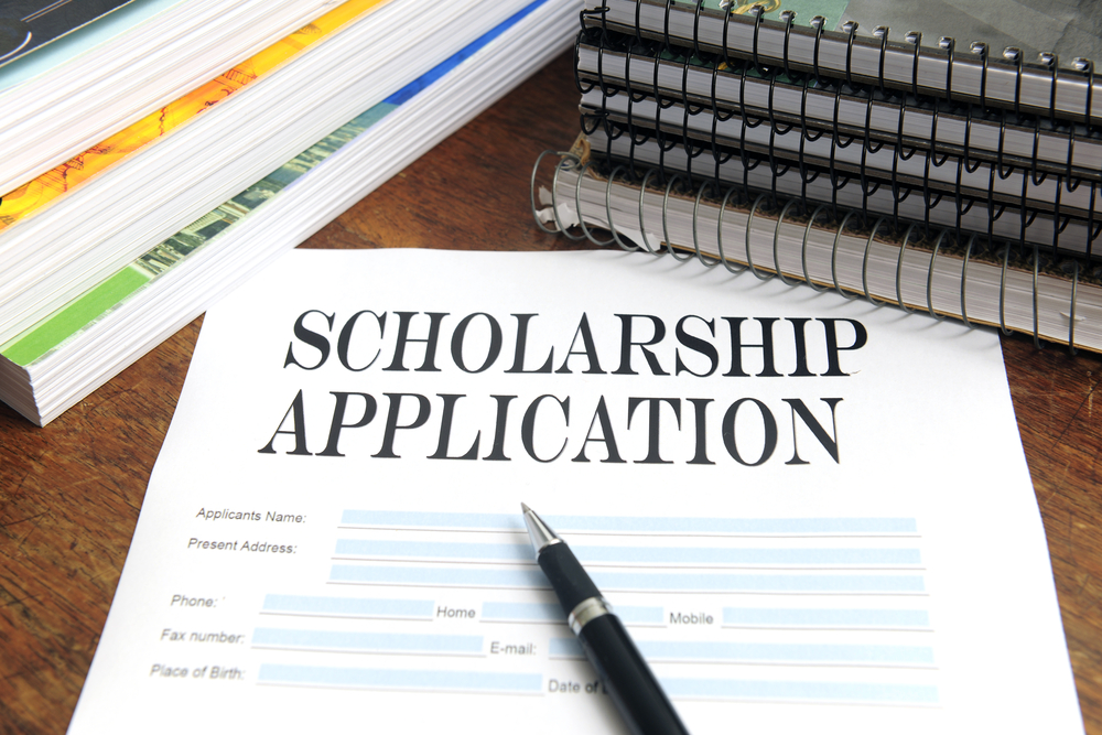 scholarship application on desk among books