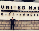 photo of student standing in front of United Nations sign