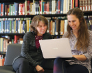 photo of two students with laptop